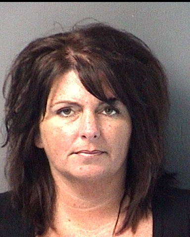 A 39-year old Century woman is accused of throwing an open house party last