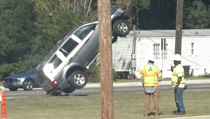 photos suv driver runs up power pole guy wire northescambia com