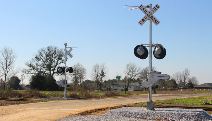 Two railroad crossings being installed in walnut hill