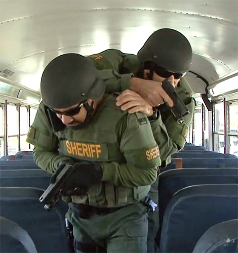 County Commission First Reading Of Peavine Shooting: SWAT Team Conducts School Bus Hostage Training