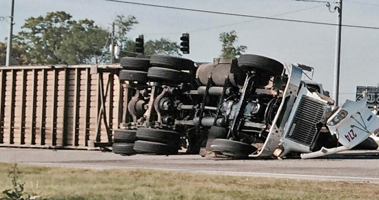 Driver Injured, Traffic Disrupted When Chip Truck Overturns