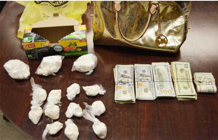 man arrested with large purse full of cash and cocaine