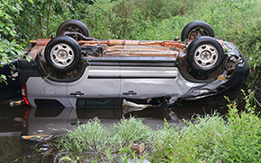 Driver Flips Vehicle Into Water-Filled Ditch