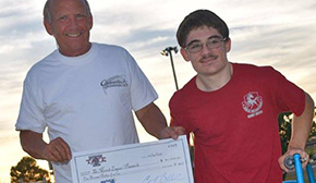 Markus Baxley, Aggie Nation Present $1,000 To Miracle League