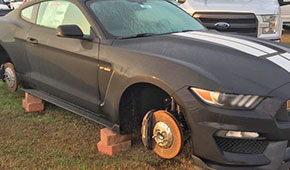Thief Strips Wheels From Mustang, Leaves It On Blocks In Front Of Dealership