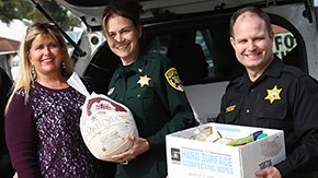Escambia County Jail Staff Delivers Thanksgiving Food For Families In Need