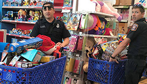 Firefighters, Cops Shop For Toys For Tots (With Gallery)