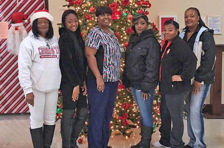 local charity dedrias gift presented christmas donations saturday to the residents of westgate village in brewton the atmore nursing care center and