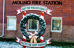 Third Red Bulb Placed On Fire Safety Wreath