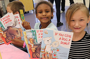 IP Celebrating Reading With Book Donations To First Graders At 11 Schools