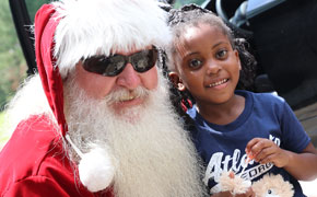 Christmas In July: Santa Takes Part In Walnut Hill Toy Giveaway